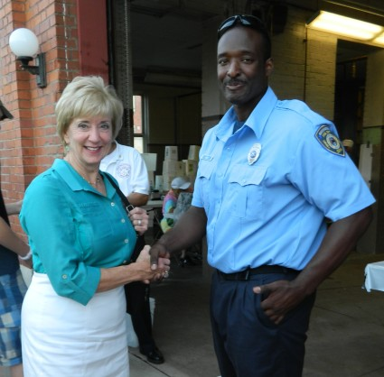 Republican candidate from Connecticut fro U.S. senate, Linda McMahon shakes hands with firefighter Ernest Jones during the Peach Festival August 24 in Manchester, CT.