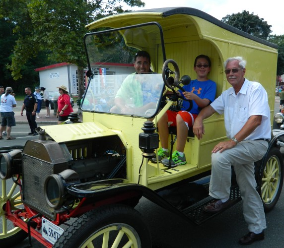 Photo by Jacqueline Bennett Three generations of the Hoch family that owns and operates Shady Glen Dairy Stores are pictured in their vintage dairy delivery truck at the 2012 Cruisin on Main in Manchester, CT. Left to right Bill Hoch, Jr., his son Taj Hoch and his father Bill Hoch, Sr.
