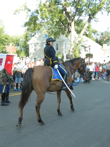 Photo by Jacqueline Bennett First Company Governor's Horse Guard marches in the 2012 Eastern States Exposition Connecticut Day Parade, West Springfiield MA.