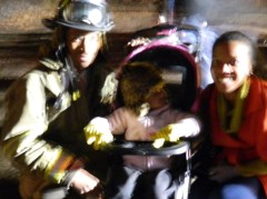 Windsor Firefighter Chris Baker with his wife Hope and their daughter Ava, 2.