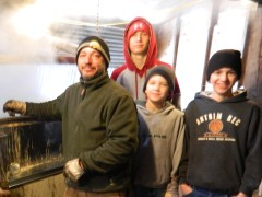 Dan Comte inside the sugarhouse on March 23, 2013 with his three sons, Tyler, Anthony and Andrew.