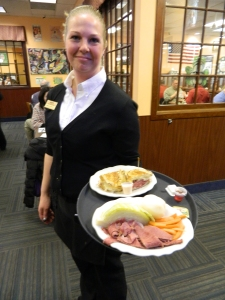Melissa Henry serves a corned beef & cabbage dinner.