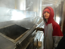 Tyler shows the hundreds of gallons of sap the evaporator can hold