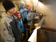 Andrew, Abby, Charlotte and their mother Heather watch the boiling off process.