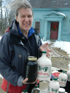 Susan Comte displays maple syrup produced at the Comte Farm sugarhouse in Nottingham, New Hampshire.