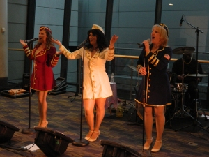 As part of a patriotic welcome home for the WWII vetrans, the Glamour Girls sang tunes from the 1940s.
