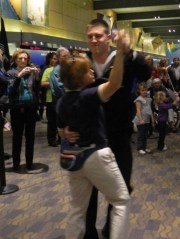 Seaman Cameron Slate of Knoxville, Illinois, dances with Bradley Airport Marketing Coordinator Stacey Doan.