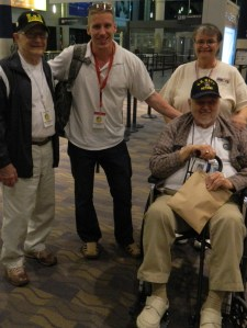 American Warrior Founder Chris Coutu and his assistant Sue Ponder shown with WWII veterans who took the April 27, 2013 Day of Honor trip.