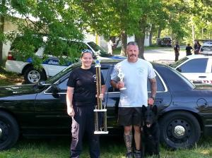 Courtesy photo: At the 2013 Region 4 USPCA Trials, shown holding therr trophies - Alyassa Larson shown with Officer Steve Vesco and Iko.