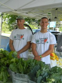 'Eat Real Food' is the motto of Cugno's Farm as seen on the t-shirts worn by father and son Darren and Nicholas Cugno of Colchester CT.