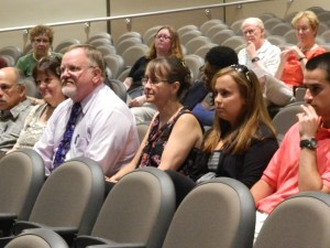 With his wife and a daughter at his side, Windsor, Connecticut Mayor Don Trinks listens to nominations at the July 18 Democratic caucus.