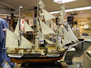 A model of the Charles W. Morgan sails unfurled, on display at the museum gift shop.