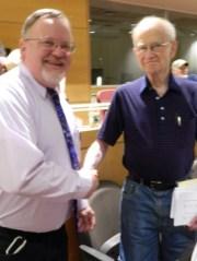 Mayor Donald Trinks is congratulated by Leonard Swade.