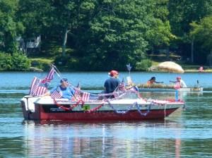 Showing patriotic spirit in the 2013 Lake Hayward Days Boat Parade.