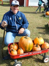 John Barbarotta shows the wagon full of pumpkins picked out by his granddaughter.
