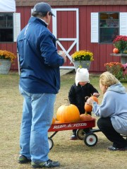 John Barbarotta and his wife drove up from Trumbull to bring theri granddaughter Reese to pick out a pumpkin or two.