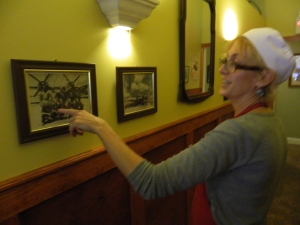 Kim shows a photo of her father who served as a gunner in WWII.