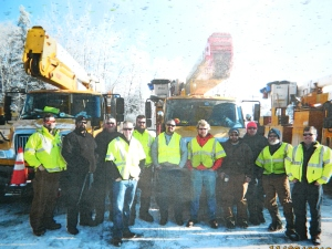 CL&P linemen 'Heroes of the North '- back row left to right: Steve Botti, Keith Portier, Mike Larned, Matt Charron, Wayne Harrington, Bob Mile, Tom Bongo, Fernando Vargas, Kenny LeMezux, Rick Johnson and in fron the team was led by Steve Jackson.
