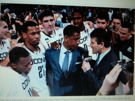 From UConn Today Kevin Ollie shown surrounded by his team last year.