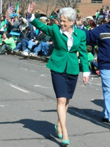 Lt. Gov Nancy Wyman waves to the crowds - note her signature high. high heels in green!