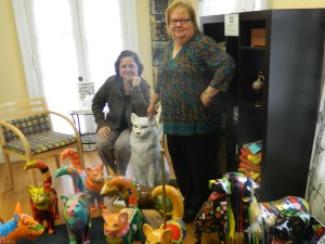 "It's ""Raining Cats and Dogs"" around artist  and Jane Garibay, Executive Director of the Windsor Chamber of Commerce. surrounded by"