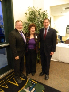 Mayor Donald Trinks and ANita Mips greet Sen. Richard Blumenthal.