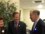 Sen Blumenthal shares a laugh with Bill Gombert, auction organizer.