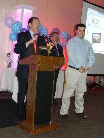U.S. Senator Richard Blumenthal shown with his new friend Matt Glad and Mayor Donald Trinks agreed to double his donation at the Windsor Chamber Cares Benefit Auction on April 4.