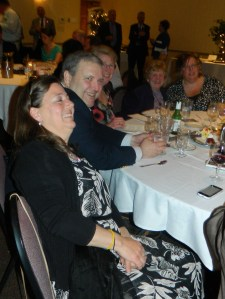 At the Walsh table, Ann Walsh (second from left) and friends enjoy the evening.
