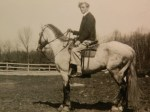 Dad/Big Johnny on horseback.