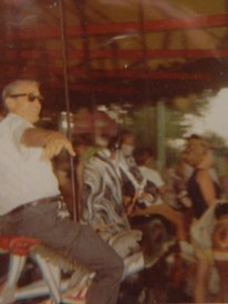 Dad/Big Johnny riding a carousel.