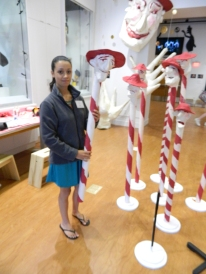 Museum Assistant Kiara Gonzalez shows a hands-on opportunity at the puppetry museum.