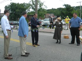 """Manchester, Connecticut Mayor Jay Moran cuts the ribbon June 14 to begin a community march along Hartford Road to  """"The Great Lawn"""" of the Cheney Mansions to commemorate the 100th anniversary of Homeland/Heritage Day."""