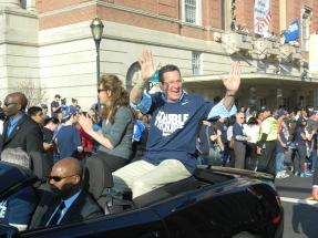 Univeristy of Connecticut President Susan Herbst (left) shown riding with Gov. Dannel Malloy in the Parade held April 13, 2014 in downtown Hartford, CT for the dual championship Huskies