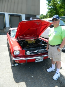 Fil Ferrauto, CT State Director of Mustang Car Club of New England, Inc. pictured with one of four Mustangs he owns.