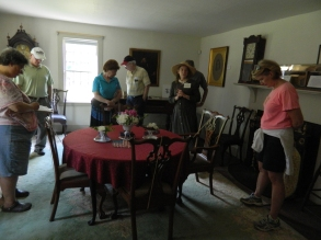 "Inside the Cheney homestead, visitors look at what was called a""controversial"" rug due to its more contemporary date versus furnishings from an earlier era,"