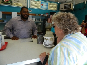 Chris Baker takes an order from Shirley King of Windsor Locks.