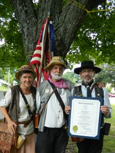 Members of the Swiss-American fife & drum corps, the Wild Bunch, display a proclamation  presented to them from the state of Connecticut.