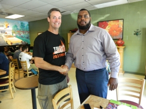 Bart's - where hometown heroes meet. NFL player Chris Baker shakes hands with fellow WHS football alum Dan Nolan, who served in Iraq and Afghanistan.
