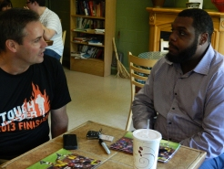 Dan Nolan and Chris Baker converse at Bart's where Baker came by to promote his foundation which aims to teach children football, literacy and leadership skills.