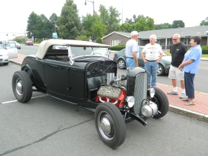 Not everyone got the news that the August 3 Cruisin on Main was postponed due to weather to August 10 - this classic car owner from tolland, CT showed up anyway.