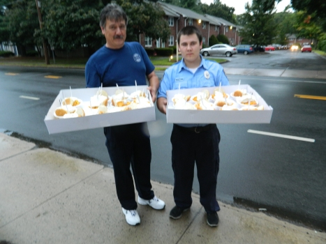 Special delivery! Father and son Stefan and Christopher Zajac, of the 8th Utilies District Fire Department in Manchester, Connecticut, prepare to make a peach shortcake run to local police officers and medics during the 65th Annual  Peach Festival held August 22, 2014.