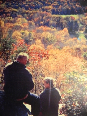 Photo by Michelle Larned Mike and Melane enjoy the beauty of New England foliage from atop a mountain at Devil's Hopyard in East Haddam, Conn.