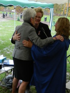 Lt. Gov Nancy Wyman embraces CTHM committe members Su and Gold Star Mother Diane.