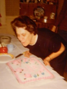 Mom/Nana blowing out the candles on her birthday cake, circa the 1970s.