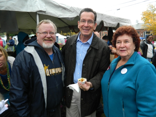 Inumbent Democrat Dannel Malloy is claiming victory in Connecticut's tight gubernatorial race. Malloy is shown here with fellow Democrats Mayor Donald Trinks and Registrar of Voters Anita Mips both of Windsor, CT at the town's  annual  Chili Challenge held in October.