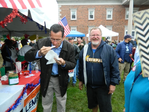 So good ... Gov. Dannel Malloy gives his approval to the chili made by fellow Democrat Mayor Don Trinks as Trinks looks on during the 2014 annual Chili Challenge held October 11 in Windsor, Connecticut.