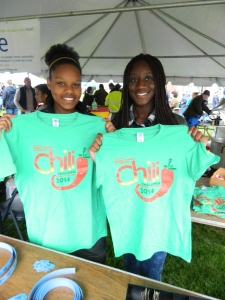 Abigail Redway and D'Andrea Koduak show the 2014 Chili Challenge t-shirt design.