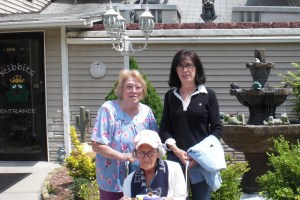 Muriel, her sister Candy and Mom shown at one of Muriel's favorite restaurants - Ribbits.