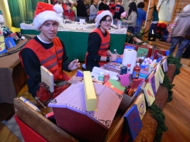 Santa's elves - Bryan Koski Bissonette of East Hartford and Megan Kelting of Tolland - were hard at work.